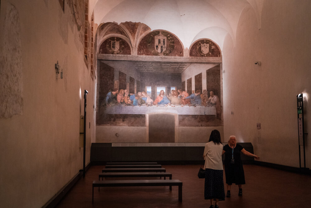 Tourists looking at the Last Supper in Milan, Italy