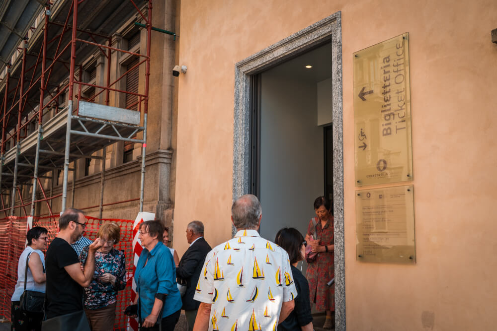 Tourists waiting in line to buy tickets for the Last Supper in Milan