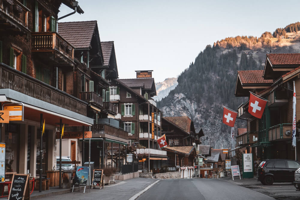 Lauterbrunnen main town view with Swiss flags