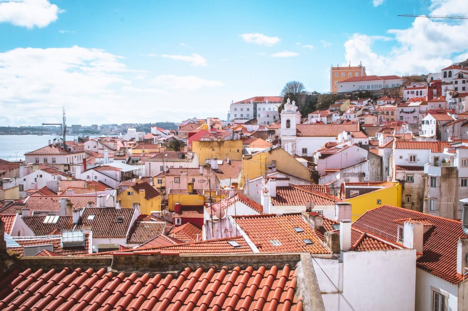 A beautiful sunny day view over Lisbon from Miradouro Santo Estêvão Belvedere