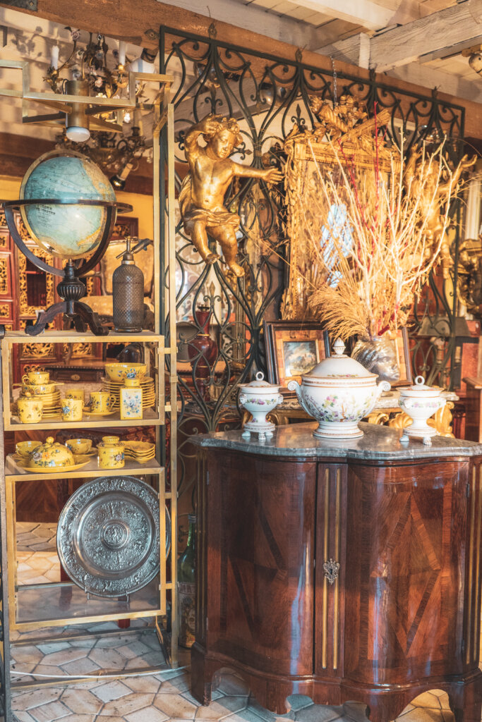 Old globes and antiques on display at the flea market in Saint Ouen in Paris