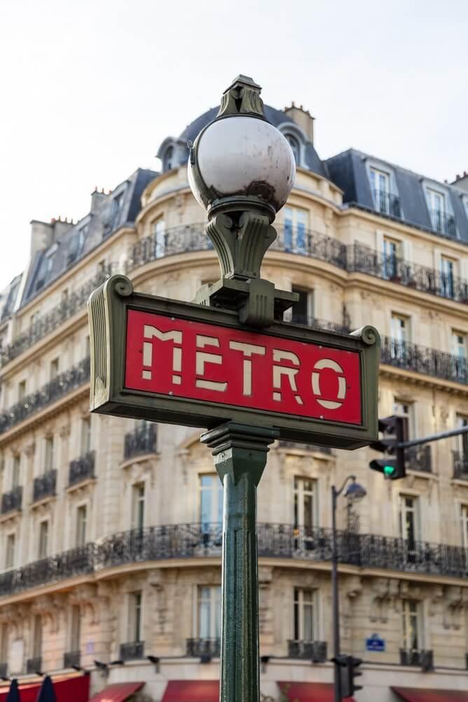 Red Metro sign in Paris, France