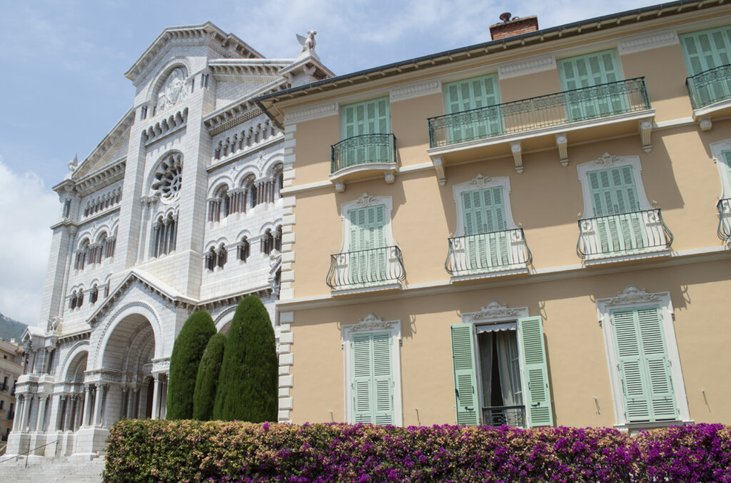 Monaco Cathedral and a peach building with mint shutters