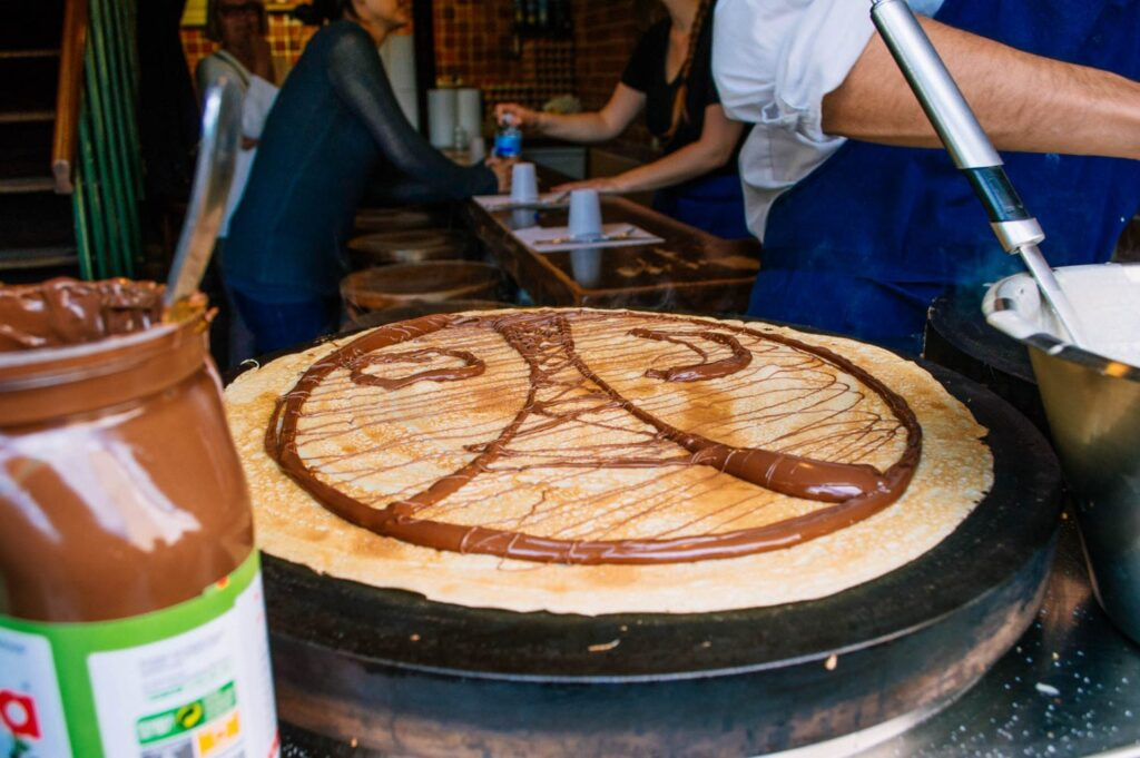 Nutella crepe with an Eiffel Tower drawn on