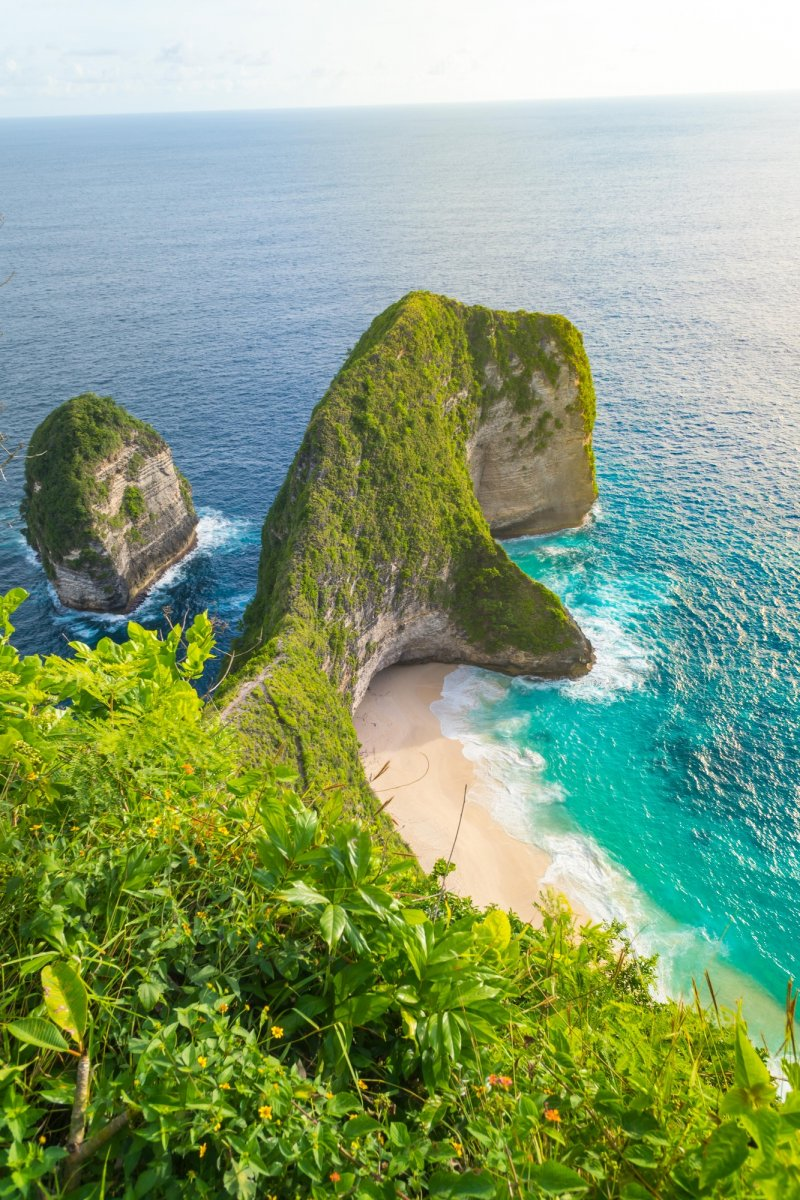Beautiful sunset and amazing view of Kelingking beach or Manta bay on Nusa Penida island, Bali, Indonesia