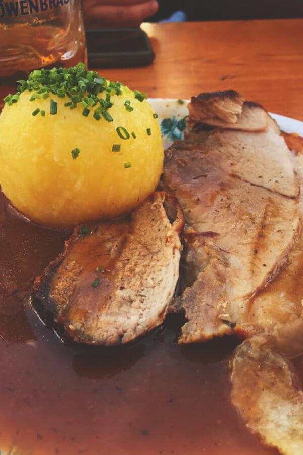 Schweinebraten with potato dumpling at Oktoberfest in Munich, Germany.