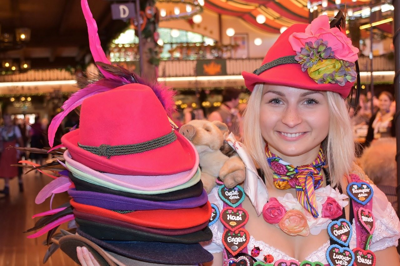 Woman selling hats and souvenirs at Oktoberfest in Munich, Germany