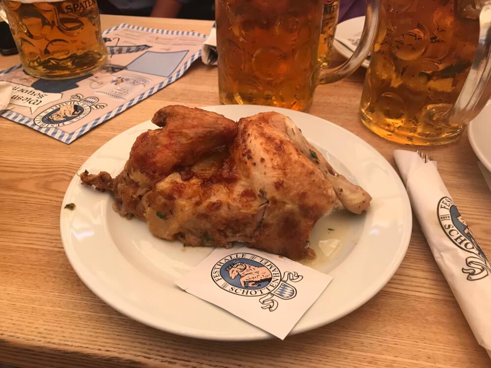 Roast half chicken at Oktoberfest in Munich, Germany.