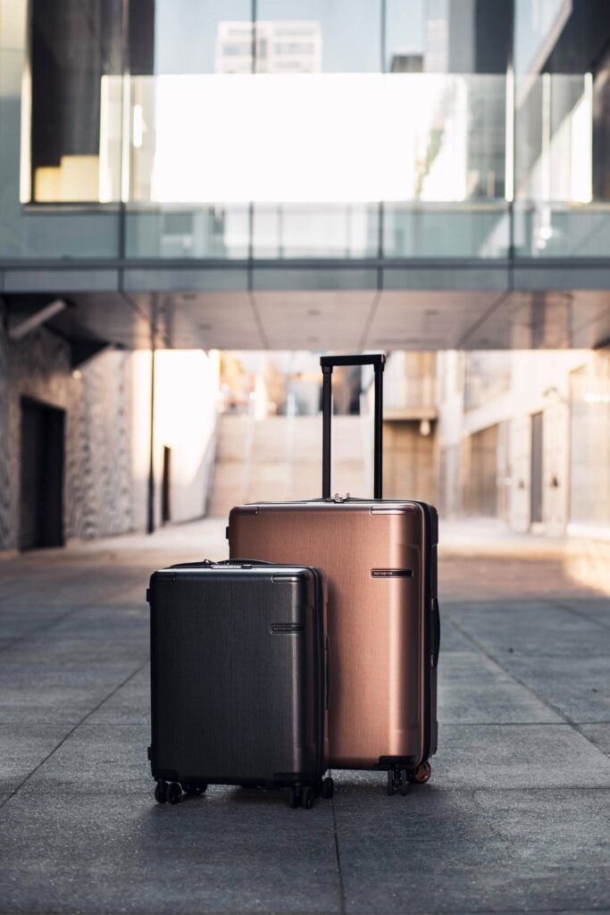 Two rolling suitcases outside on the street