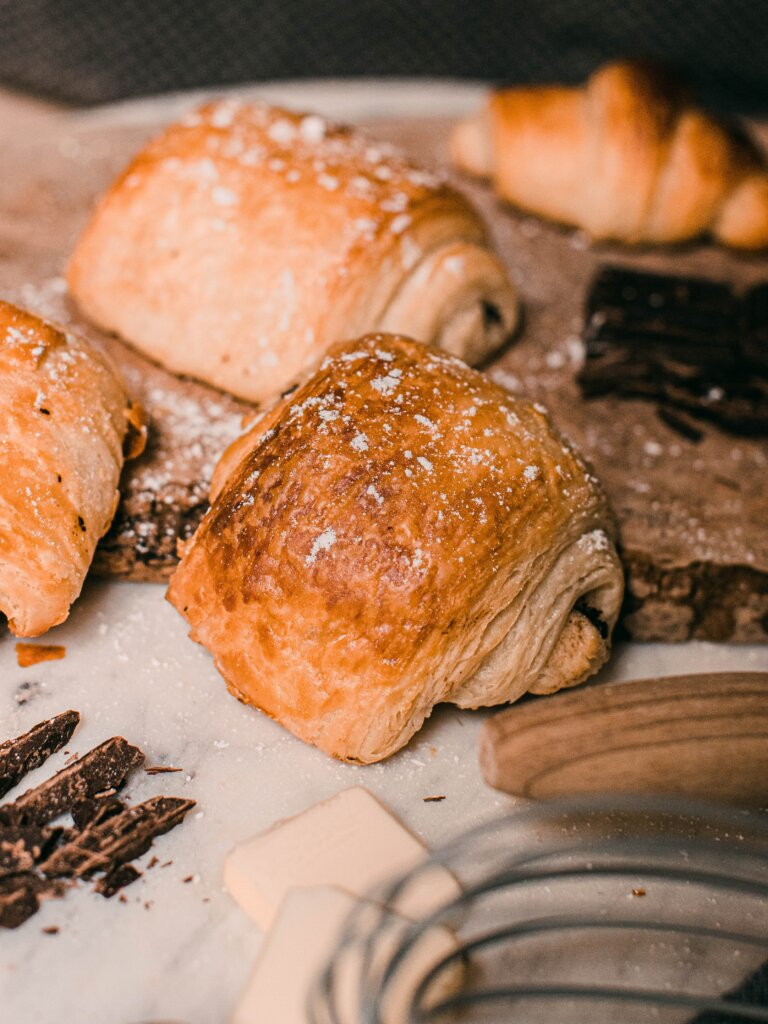 Pain au chocolats on a table during a baking class