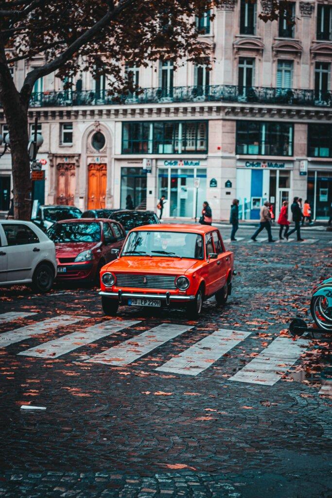 Orange car on a road in Paris