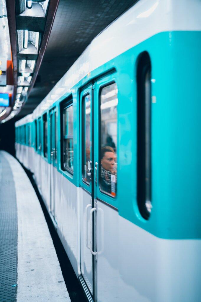 Turquoise Metro Car in Paris leaving the platform