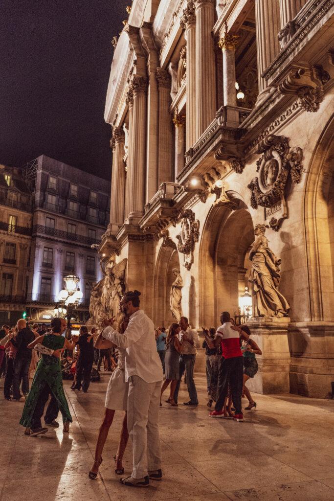 Dancers enjoying a dance in front of the Palais Garnier in Paris, France