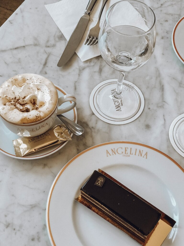 Hot chocolate and pastry on golden plates from Angelina Paris