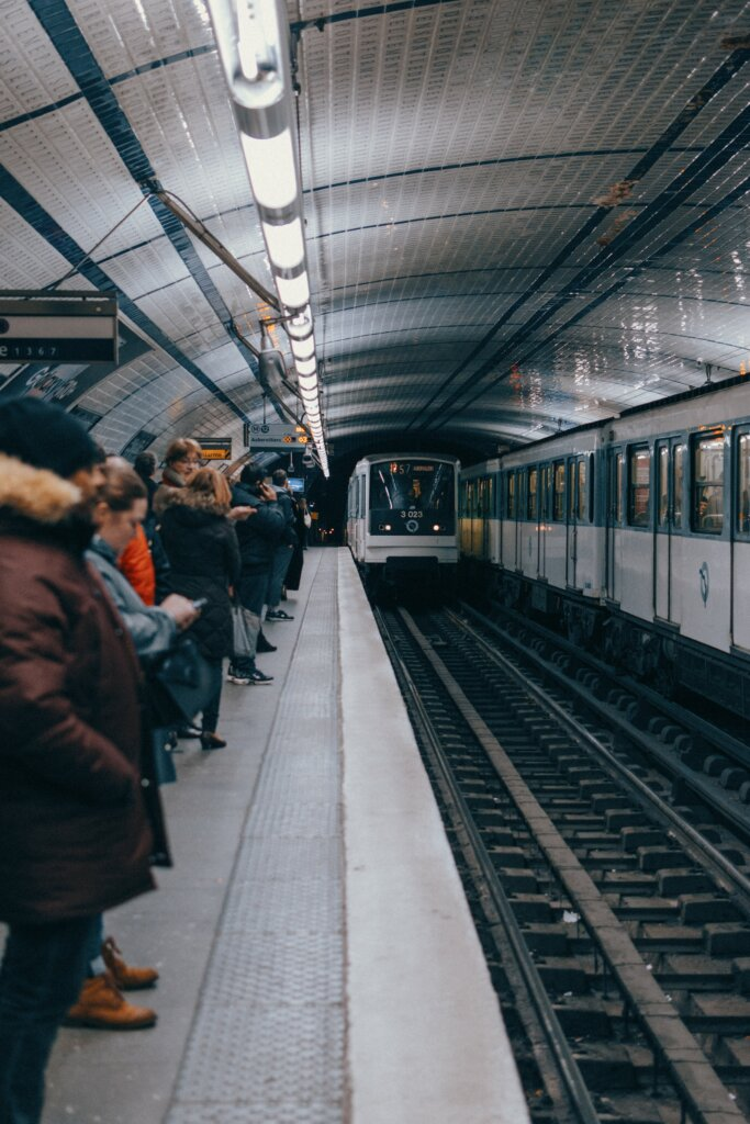 People waiting for the Metro at a station in Paris, France