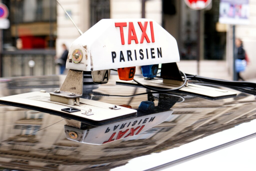 Top of a Parisian taxi with sign