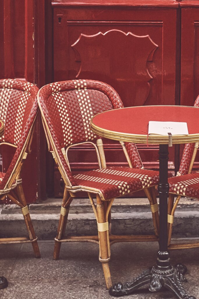 Red chair and table at Parisian cafe