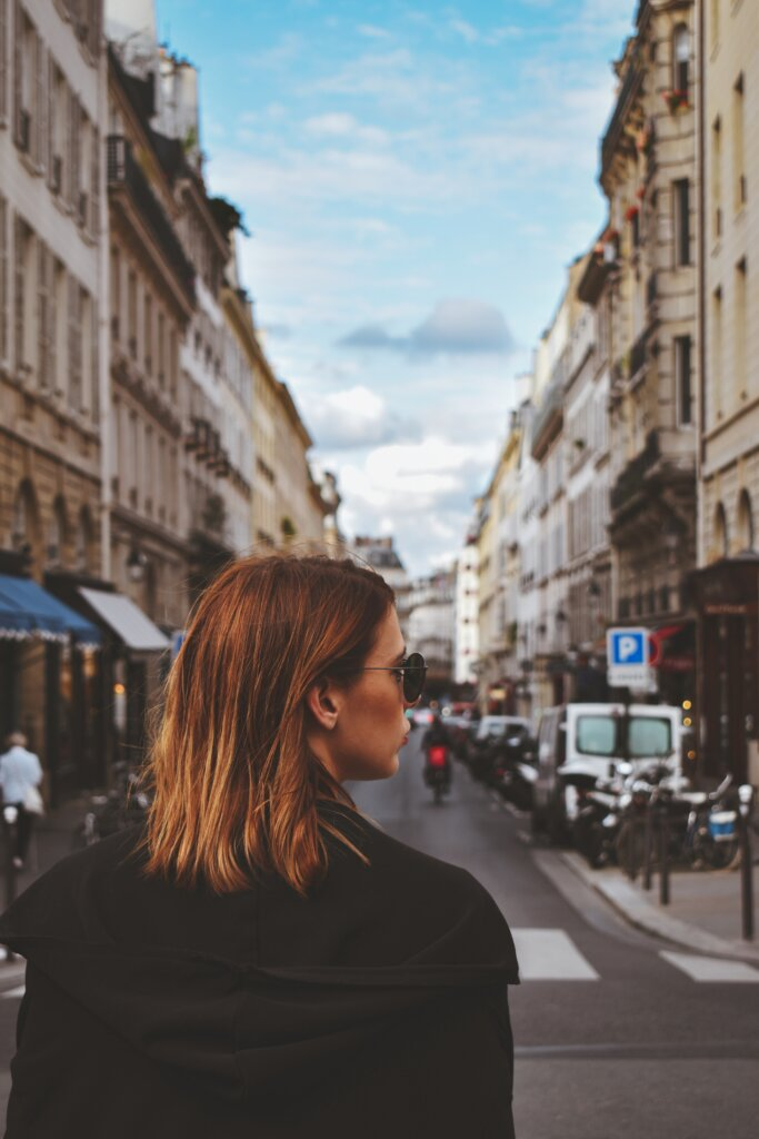Parisian woman dressed in black crossing the street