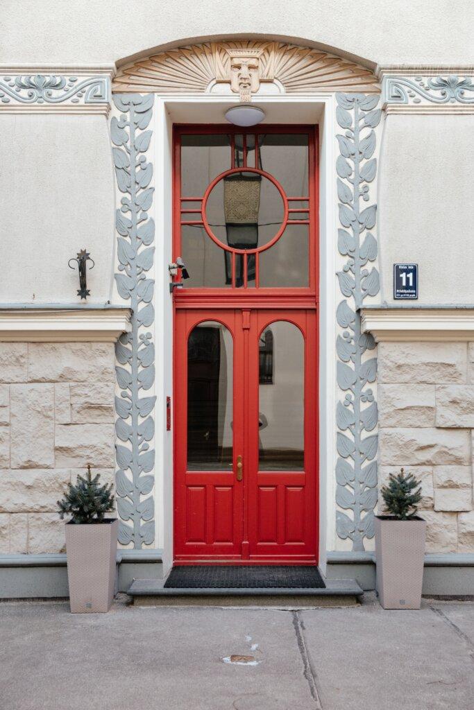 Red door at an art nouveau entranceway in Riga