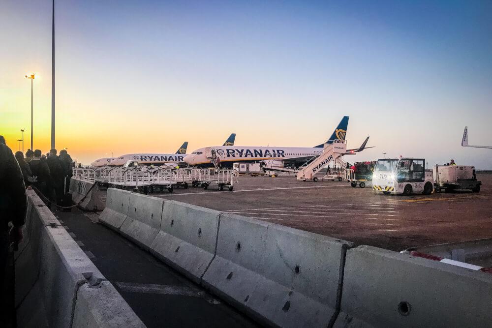 RyanAir planes at airport runway at sunrise