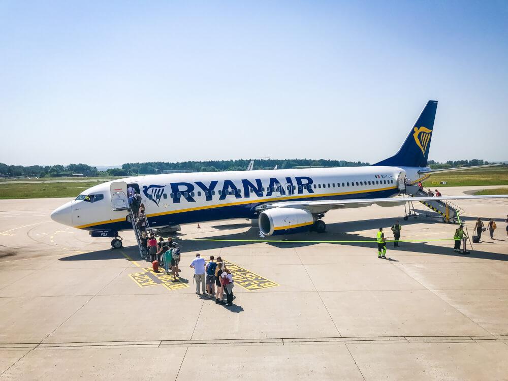 RyanAir plane on the runway with passengers walking on