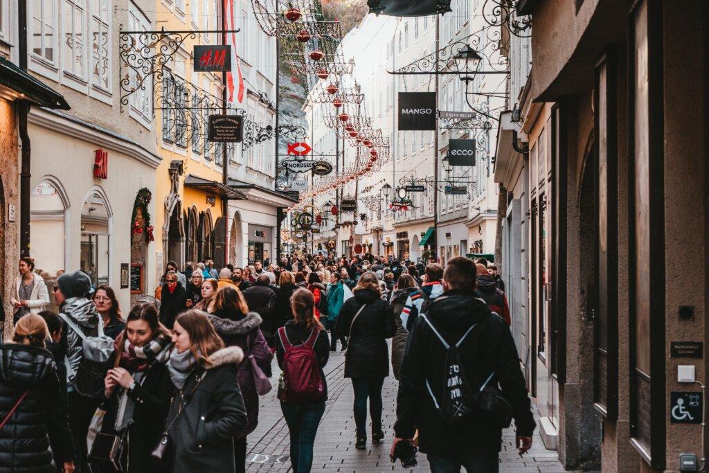 Busy crowds walking through a main shopping street in Salzburg, Austria