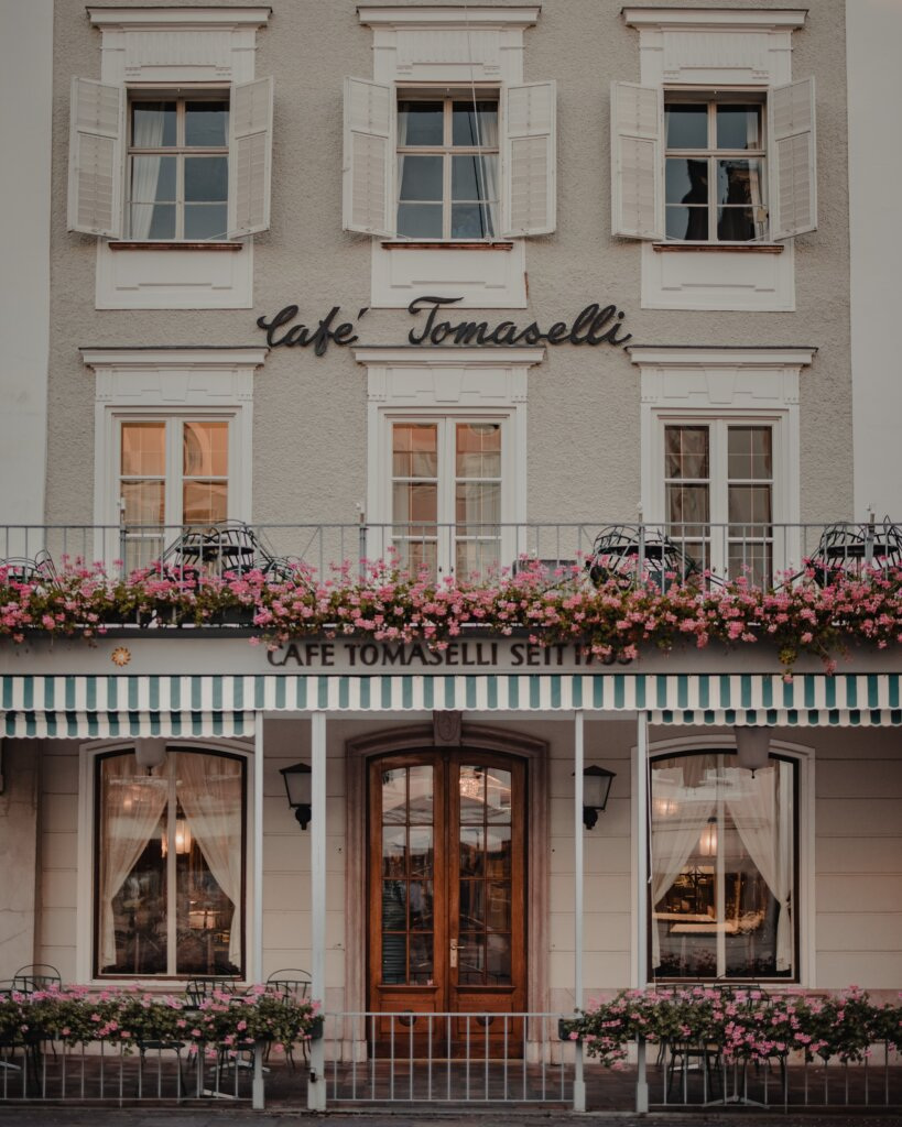 Beautiful cafe facade in Salzburg covered in flowers