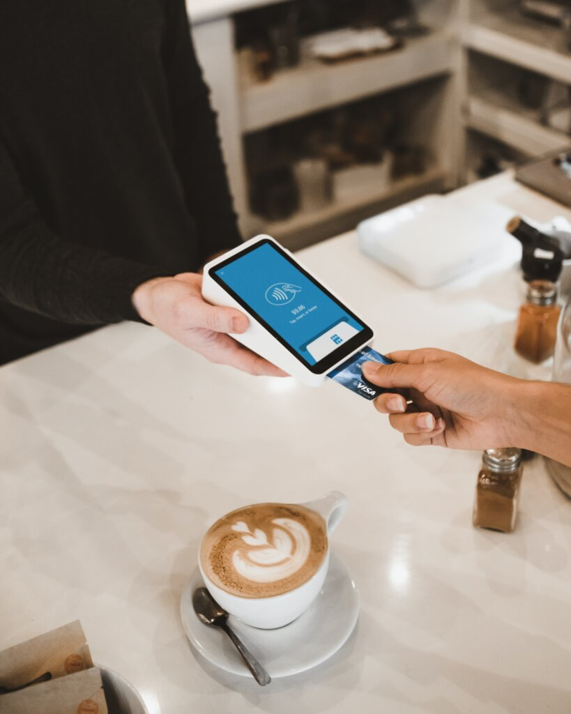 Person paying with credit card at a cafe