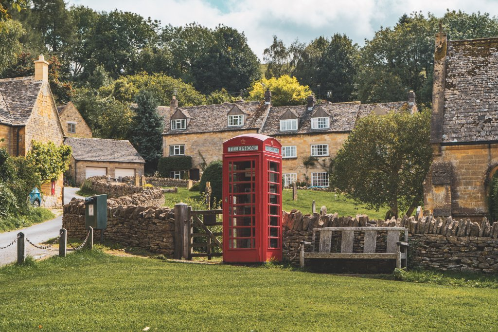 Red phone booth in Snowshill, England.