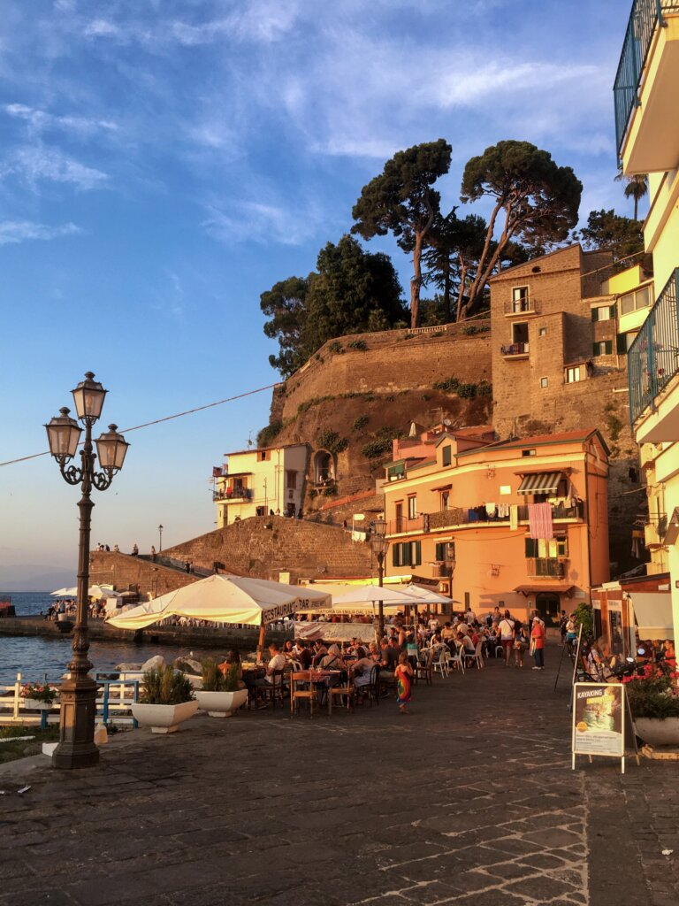 Boardwalk in Sorrento at sunset with restaurant diners