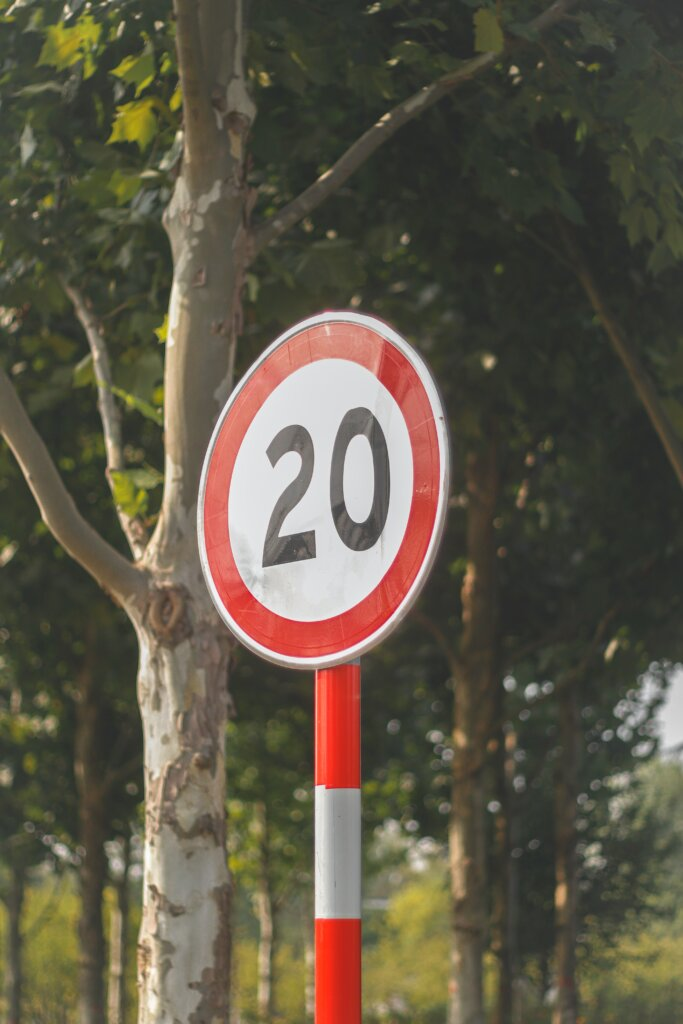 Red and white speed limit sign