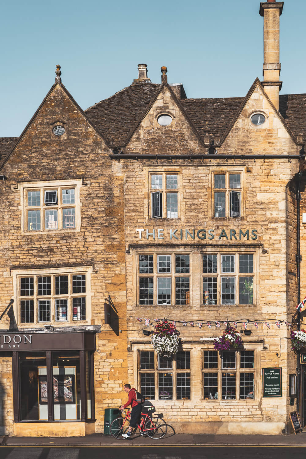 A beautiful crooked limestone pub in Stow in the World, England.