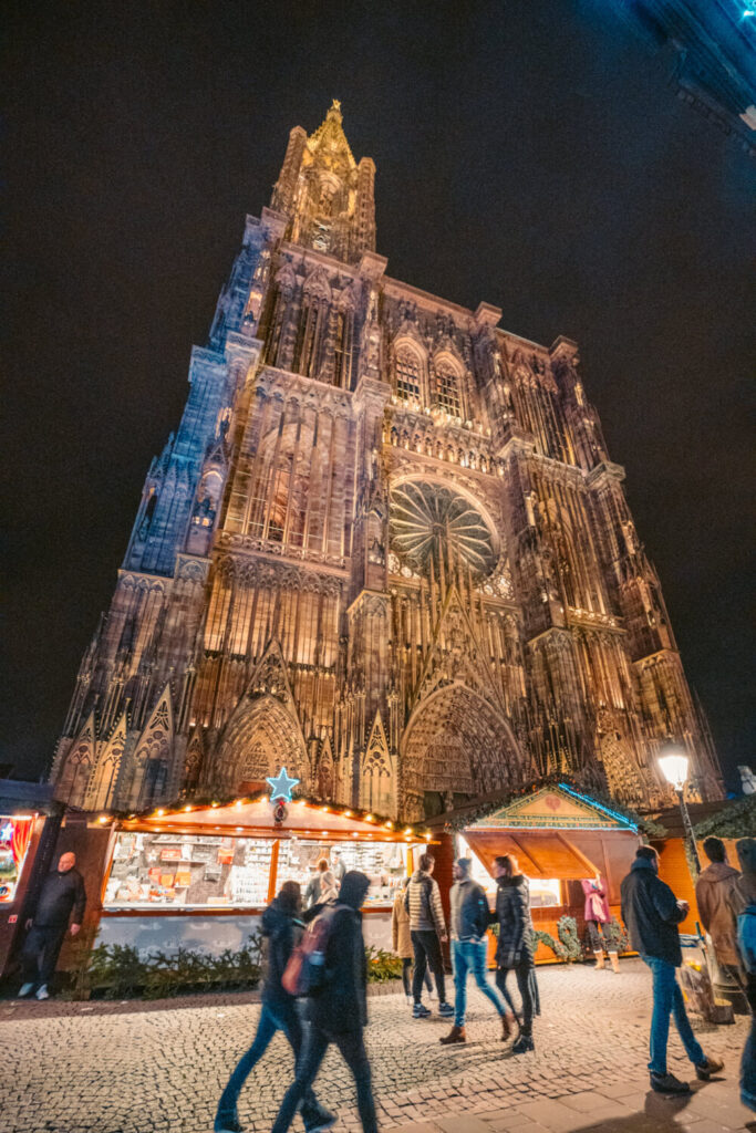 Strasbourg Cathedral at night with Christmas market stalls in front