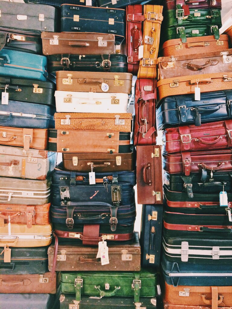 Stacks of vintage suitcases in varying colours