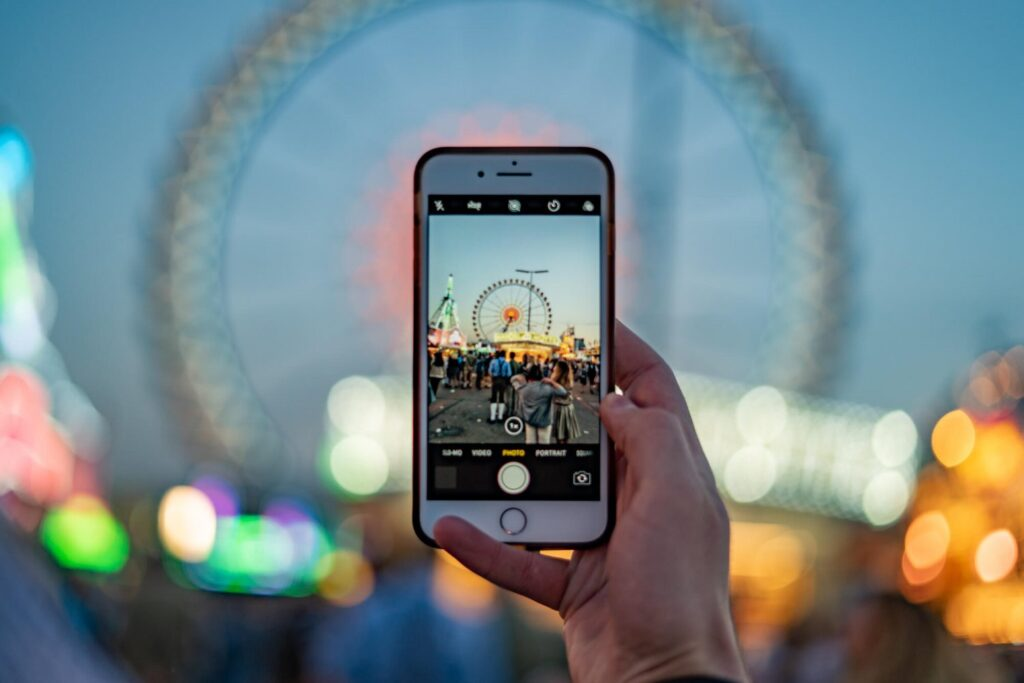 An iPhone taking a photo at Oktoberfest in Munich, Germany,