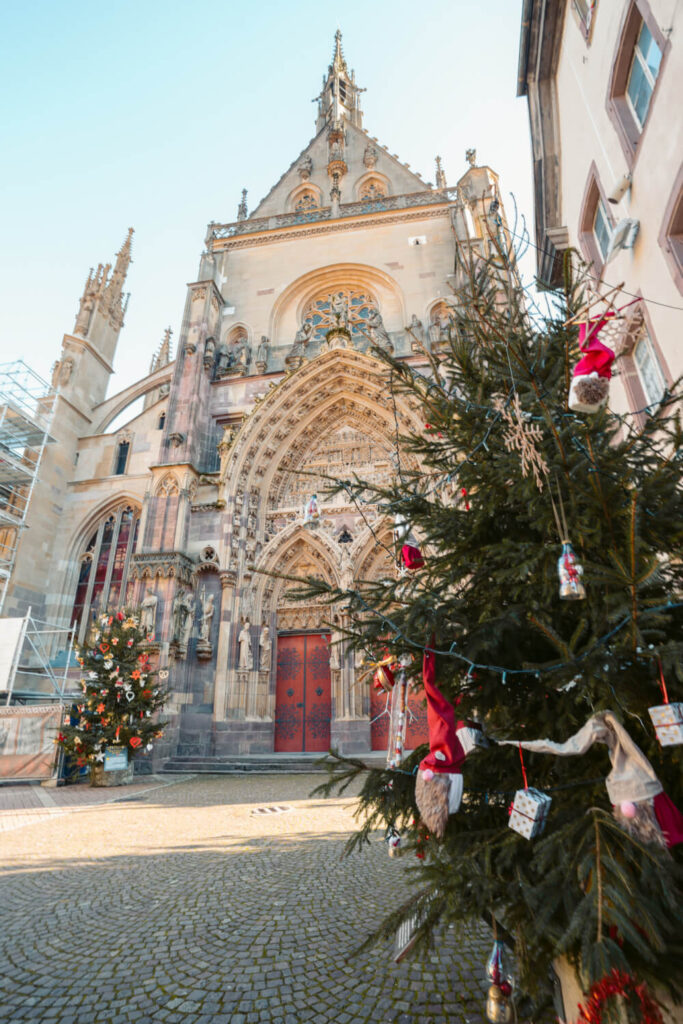 Thann Cathedral with a Christmas tree in the foreground