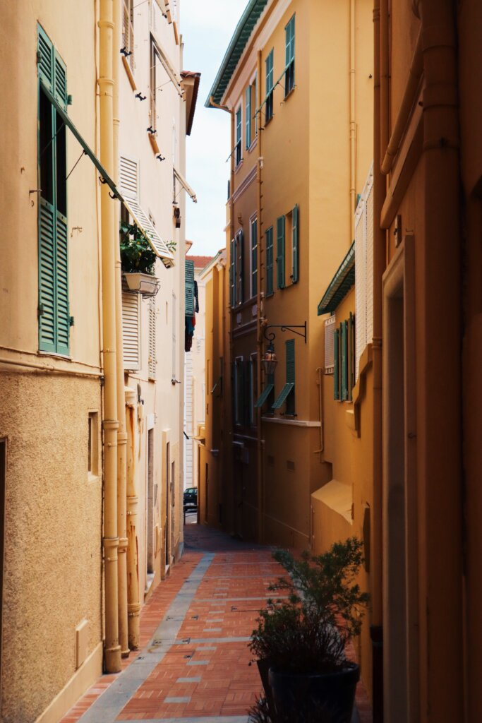 Colourful orange and pink back alley in Monaco