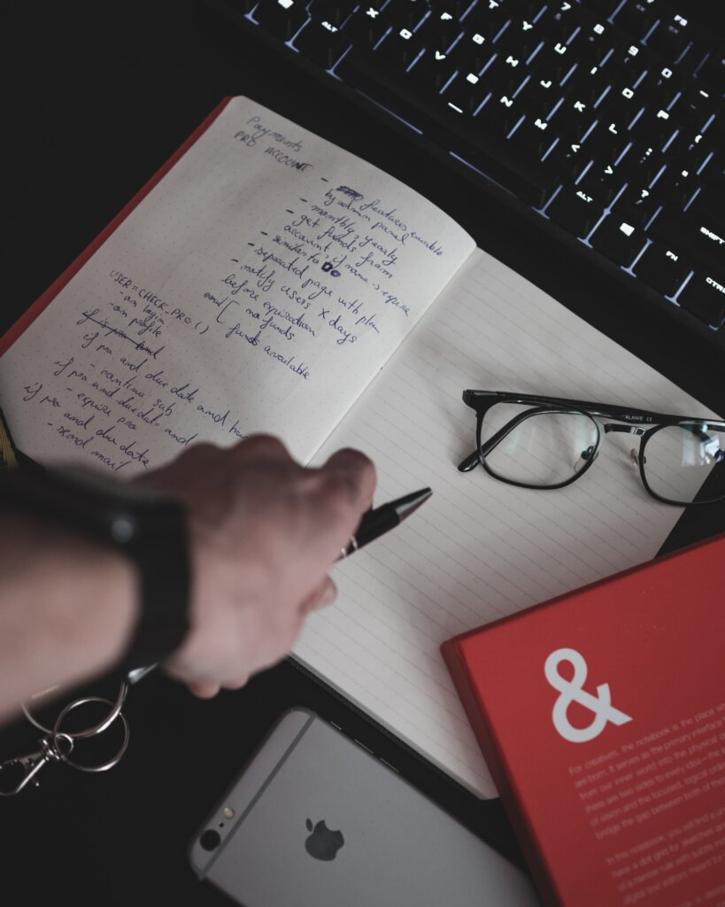 Notebook with glasses and notes on a desk