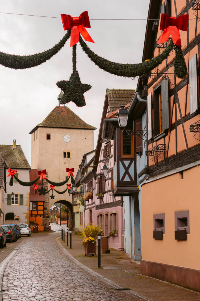Cobblestoned street lined with half timbered houses in Turckheim, France