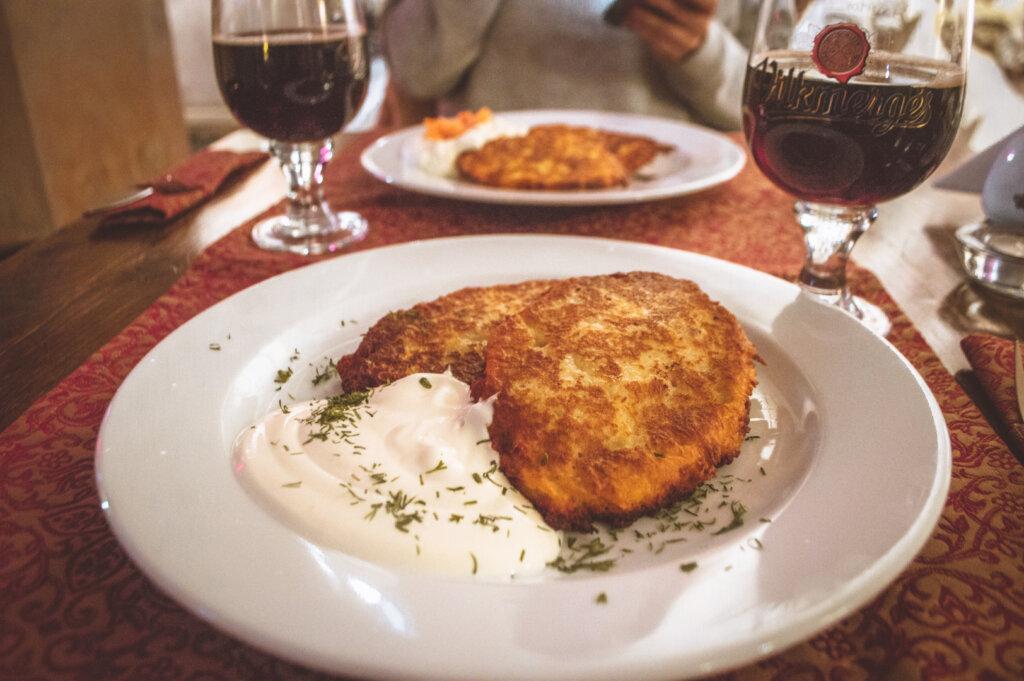 Dinner table with Bulvinai Blynai AKA potato pancakes and beer
