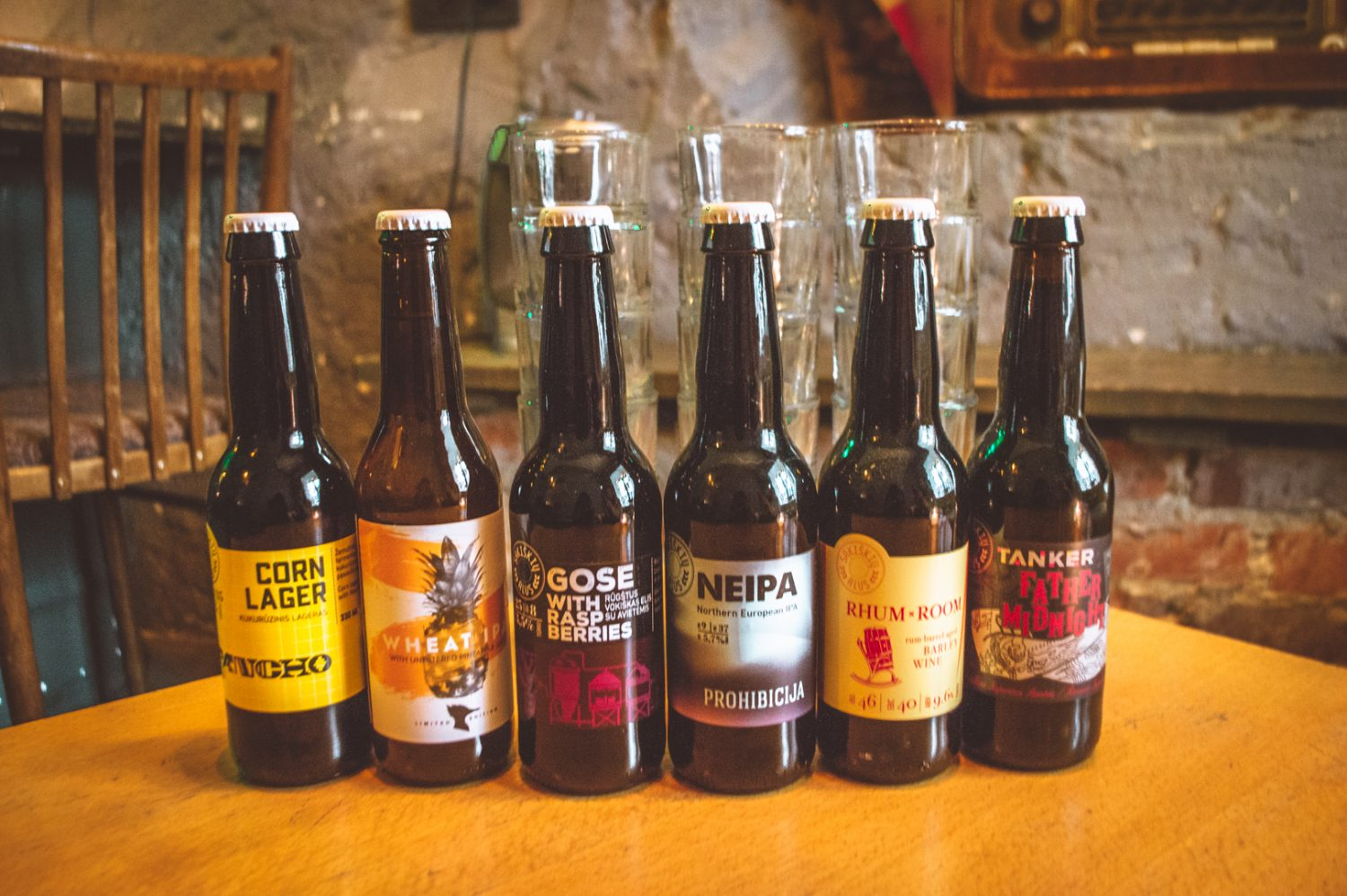 Craft beers lined up with glasses in Vilnius, Lithuania