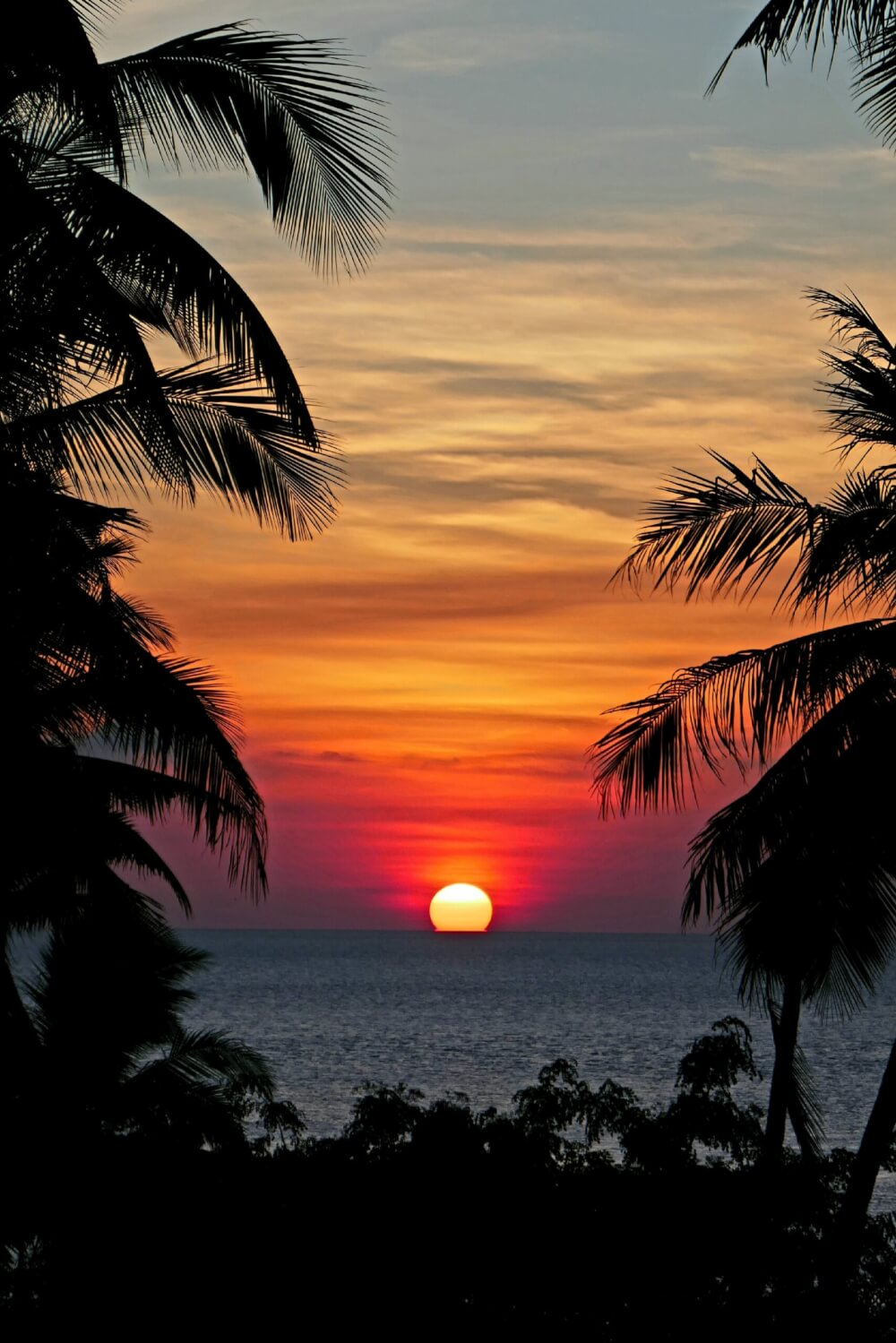 Sun setting over horizon in the Wakatobi Islands in Indonesia