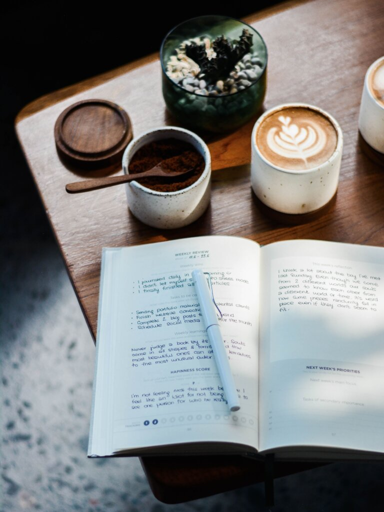Notebook and coffee on a desk