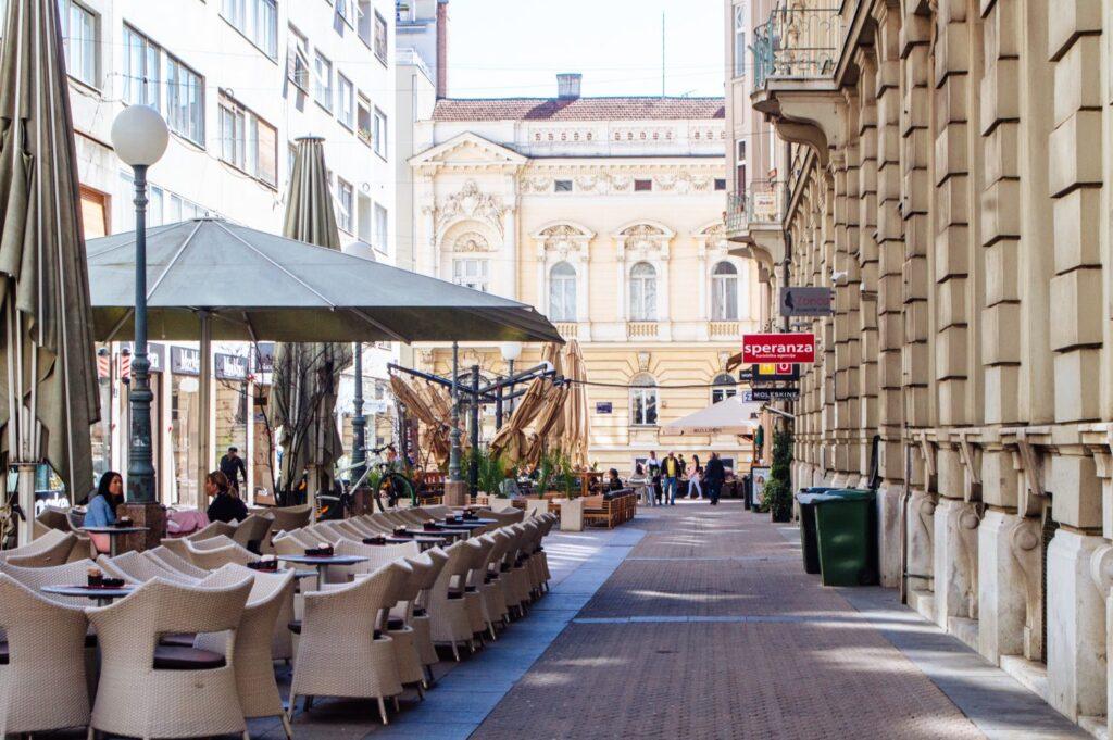 Side street with an open restaurant terrace in Zagreb, Croatia
