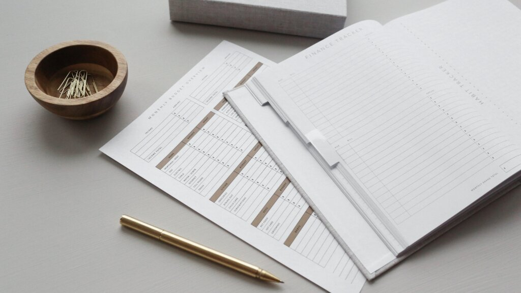 A notebook with budgeting worksheets
