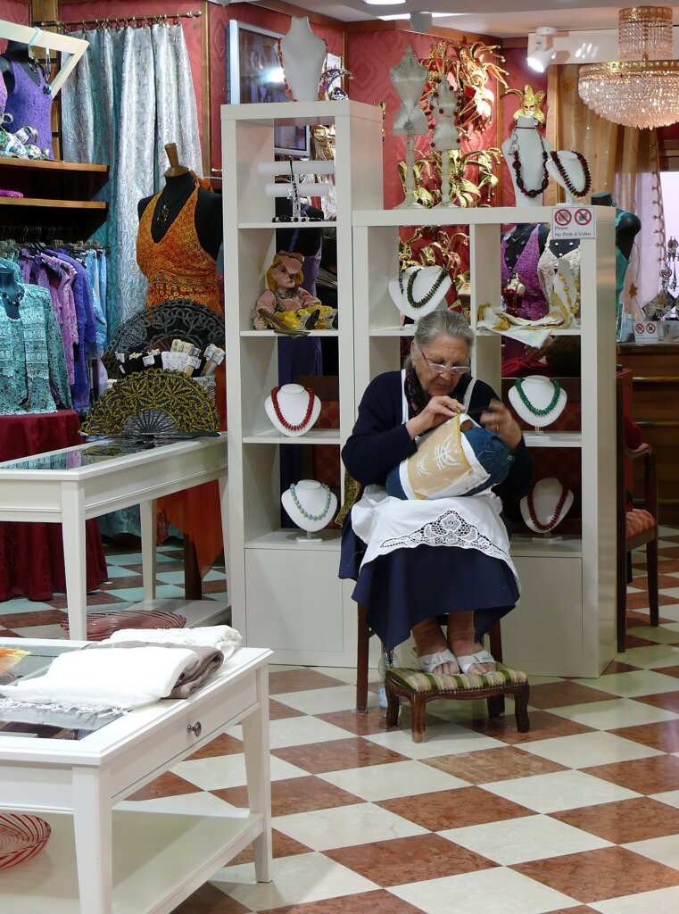 Woman doing lace work in Burano, Italy