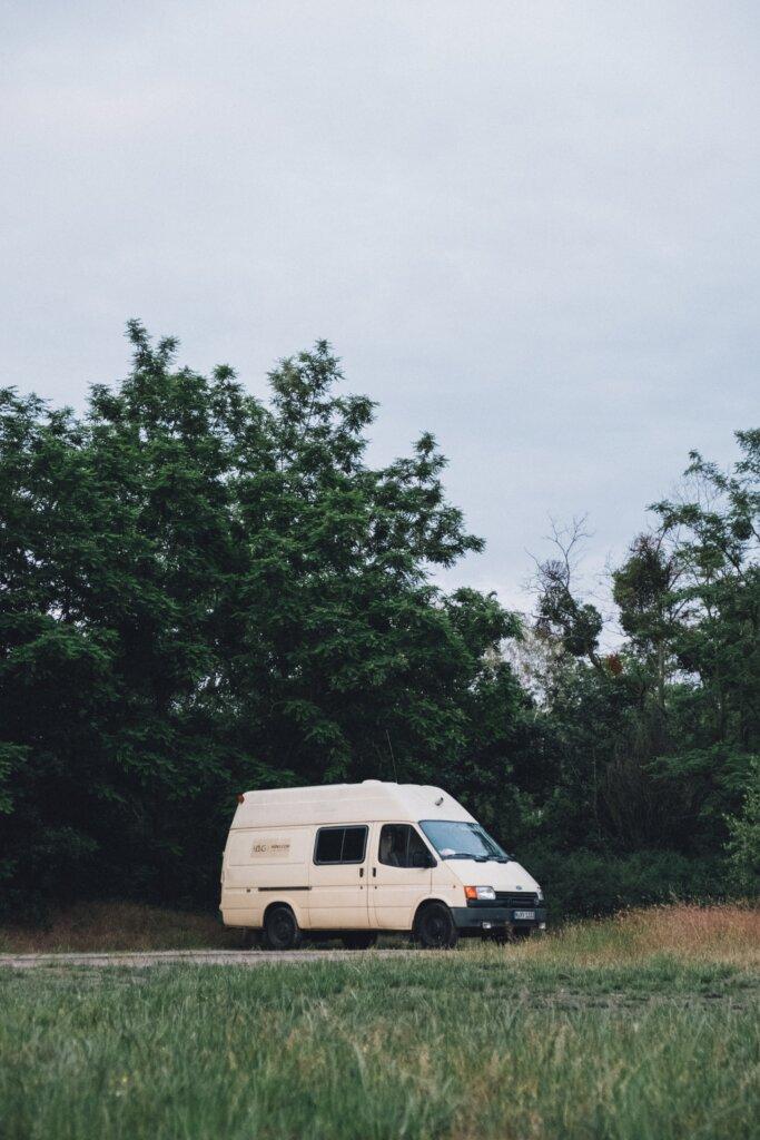 White rental van in a field