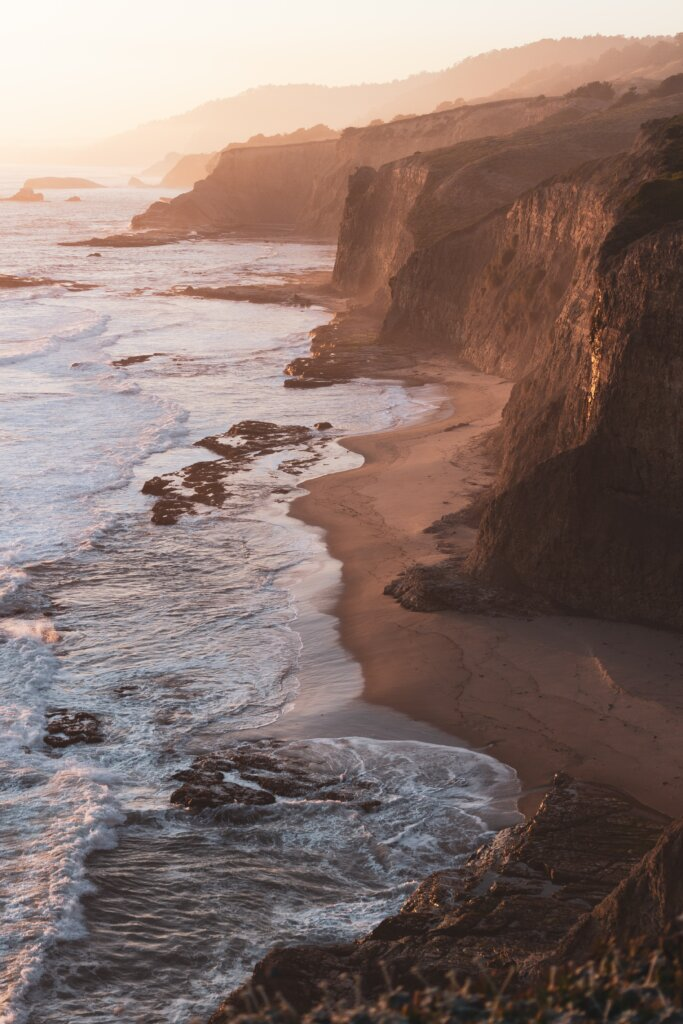 The California coastline and lapping tide, boasting countless rock formations.