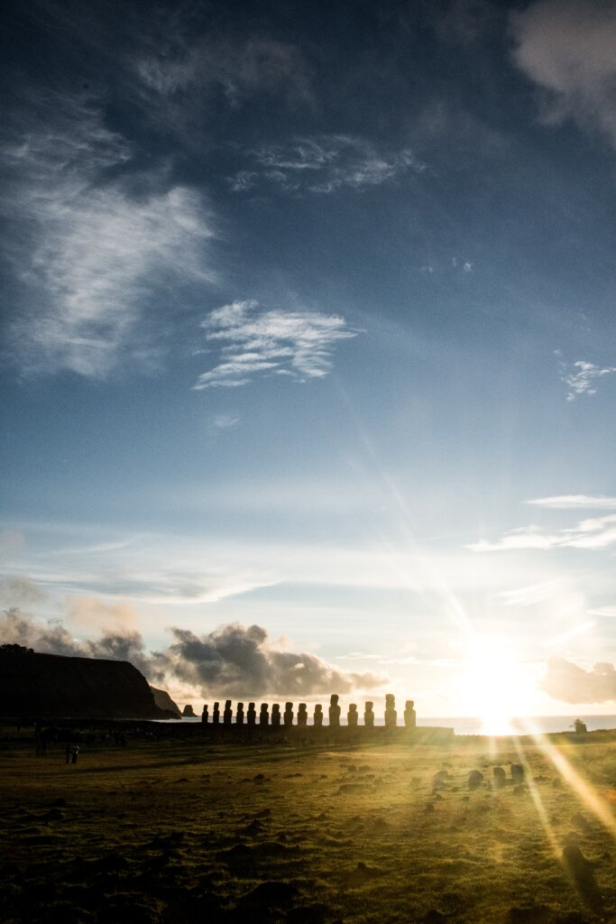 Easter Island with a big beautiful sunflare at sunrise