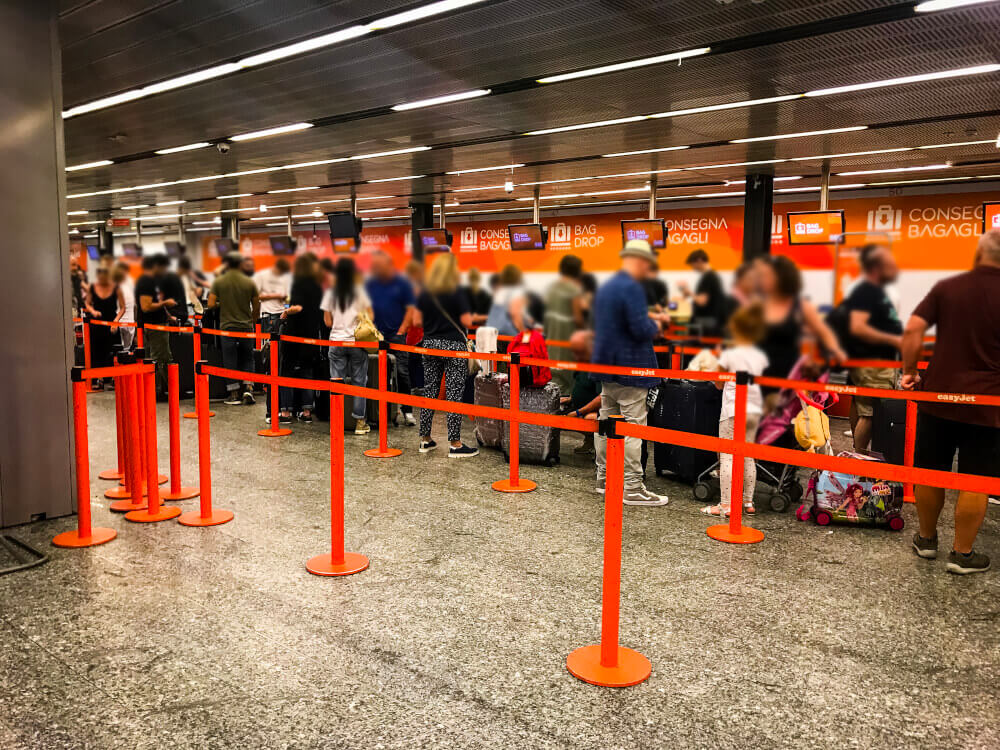 Passengers waiting in line at an easyJet check in area